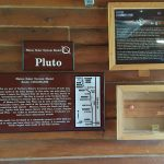display about the planet Pluto in the Houlton Visitor Information Center, part of the Maine Solar System