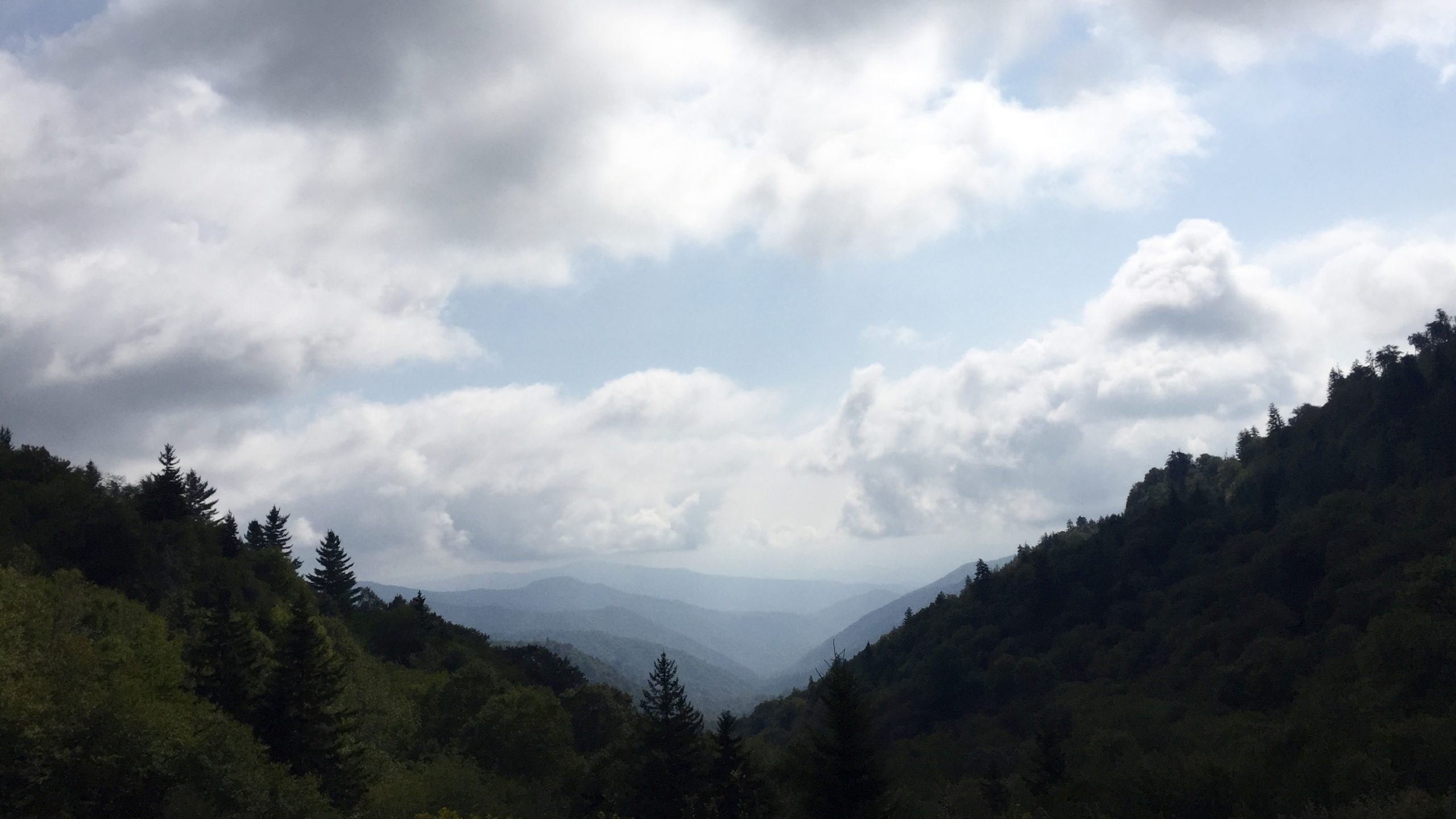 Looking down a valley at the smoky mountains in the distance
