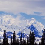 A view of Mount Denali, shrouded in clouds, taken from southeast of the peak