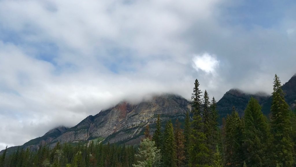 The sun tries to peek through the clouds in Jasper National Park.