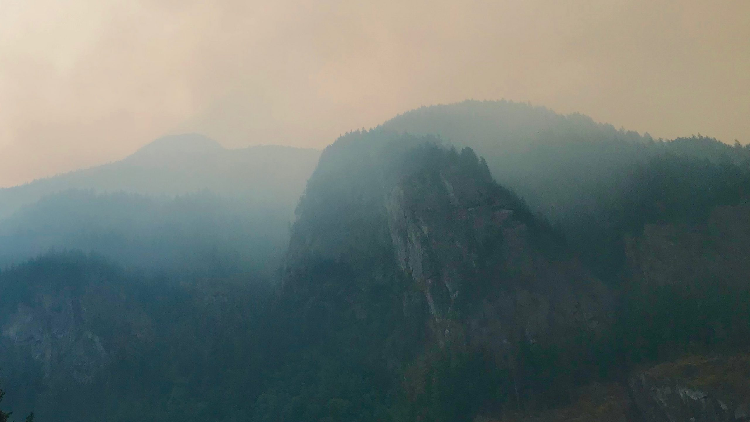 Smoke hangs over the cliffs of the Coqihalla River Canyon in Hope, British Columbia