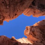 Moon Cave at Cathedral Gorge in Nevada isn't a cavern. It's a slot canyon. Looking up, you see a strip of the sky running between the canyon walls.